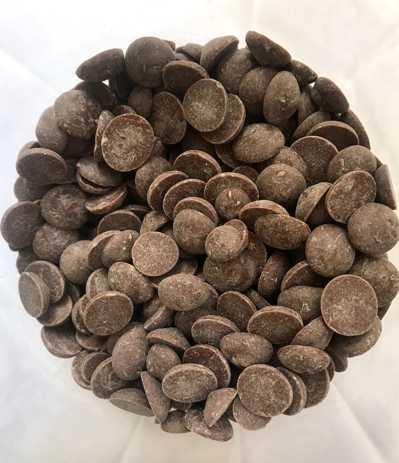 Image of a jar of milk chocolate drops in bulk, ready for your own containers