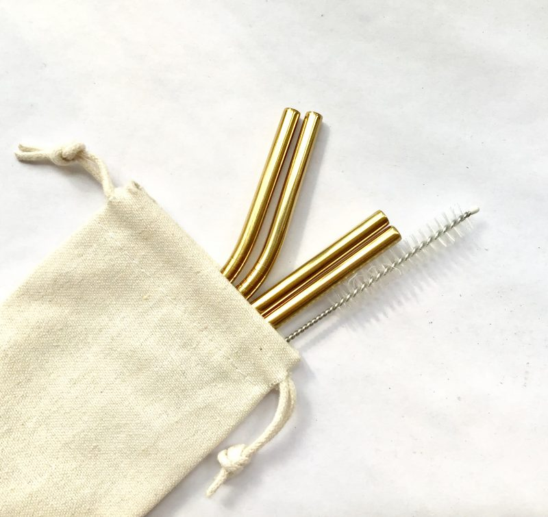 Product image of a set of 4 gold metal, reusable straws