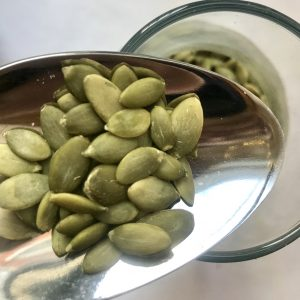 Image of a jar of pumpkin seeds in bulk, ready for your own conatiners