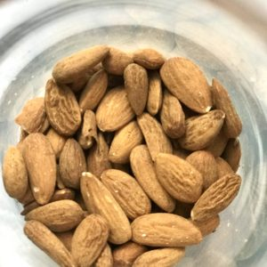 Image of a jar of almonds in bulk, ready for your own containers