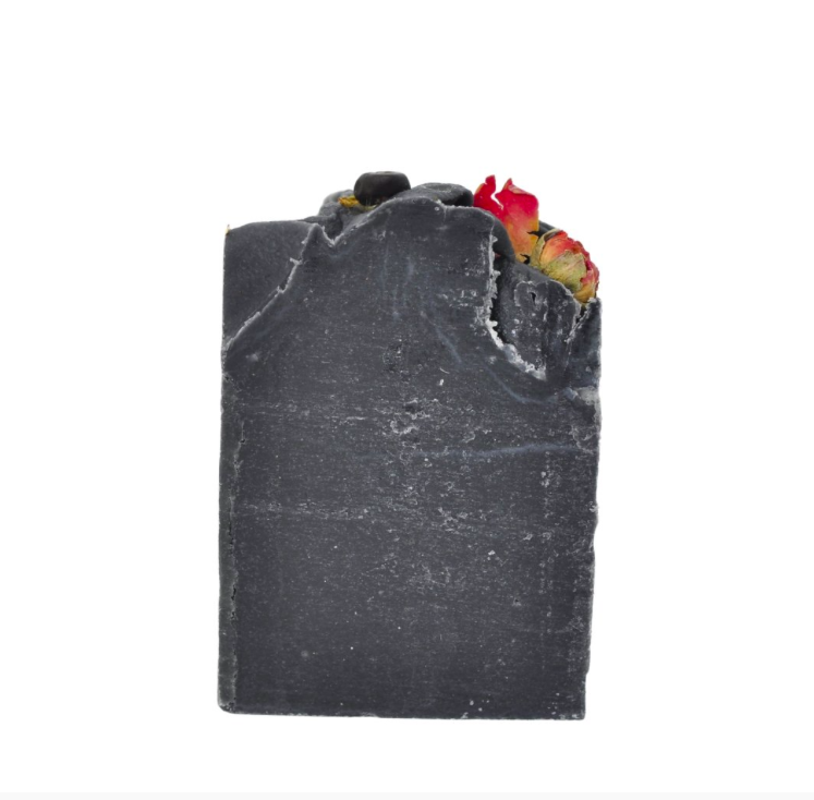 This is an image of handmade activated charcoal, detoxifying soap by Acala