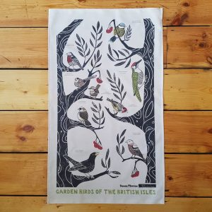 This is an image of Becca Thorne's unbleached tea towel - Garden Birds of the British Isles