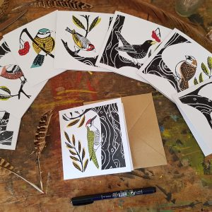 This is an image of a pack of 8 recycled cards, 'Garden Birds' - reproductions original lino prints by Becca Thorne