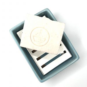 Product image of our Plastic Phobia light blue ceramic soap dish with soap (not included)